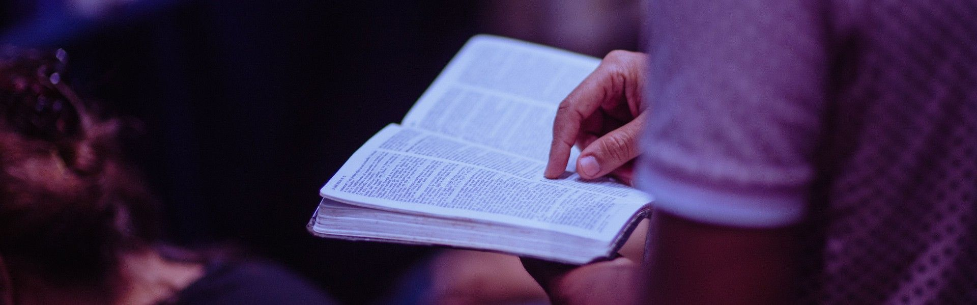 A person reading the bible and praying